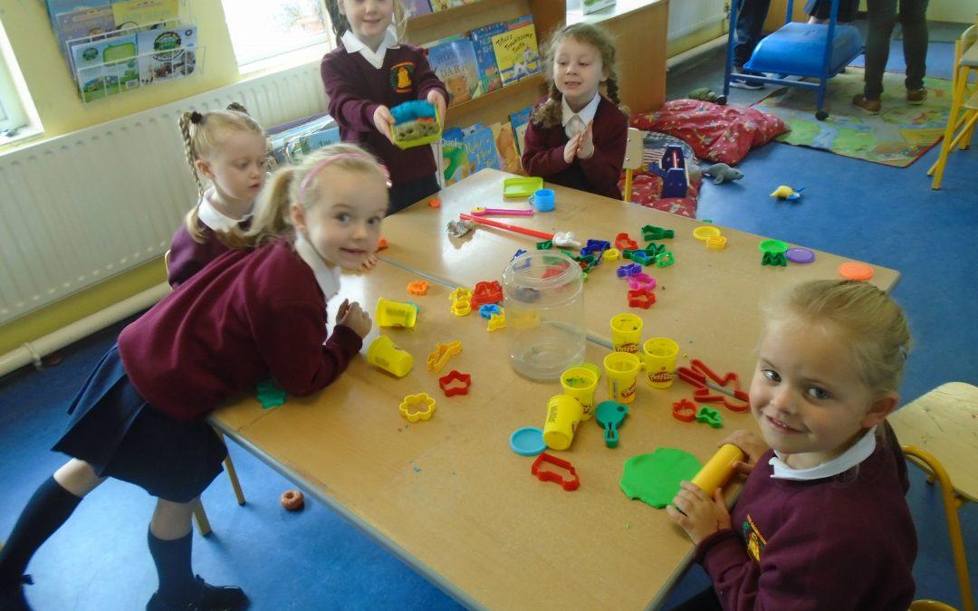 Juniors enjoying using playdough during playtime.