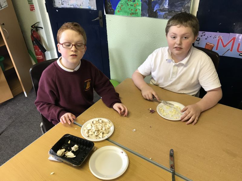 Making chicken curry in fourth class