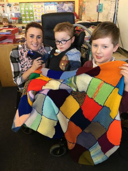 Presentation of a beautiful hand-knit blanket to Billy Goulding
