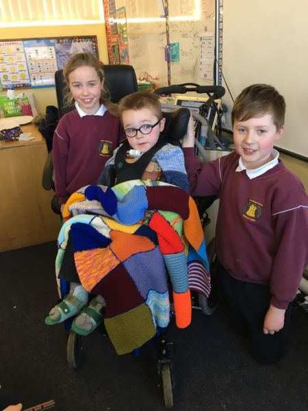 Billy being presented with the beautiful blanket knitted by 3rd and 4th class